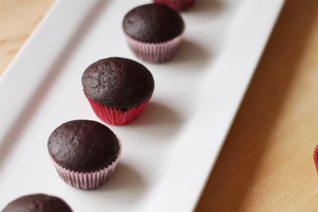 mini chocolate cupcakes on a white rectangular plate