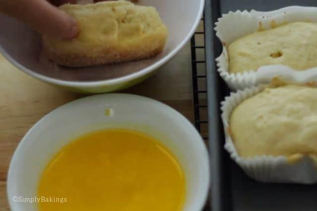 coating the bread with cinnamon-sugar mixture