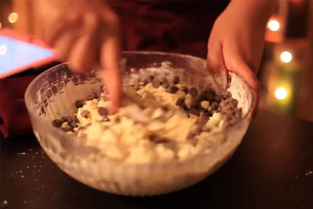 adding chocolate chips to the cookie dough