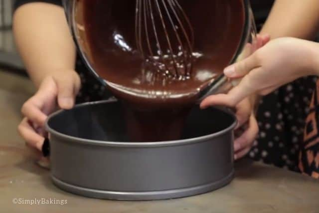 pouring the chocolate batter into the springform pan