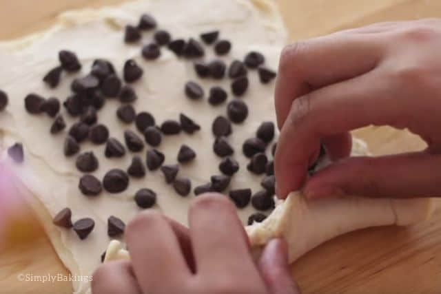 filling the crescent roll with mini chocolate chips and rolling it