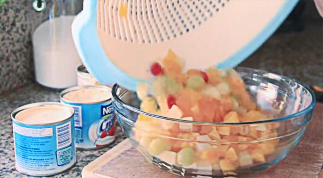 straining the fruit cocktail for filipino fruit salad recipe