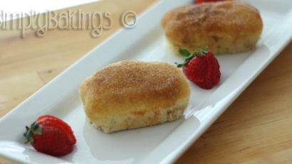 French Breakfast bread on a white place garnished with strawberries