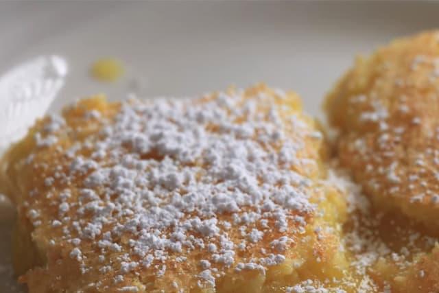 lemon bars with powdered sugar on top