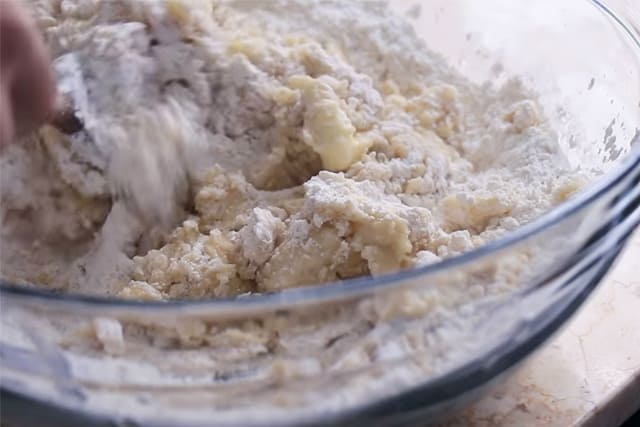Mixing the wet and dry ingredients of the lemon bar crust
