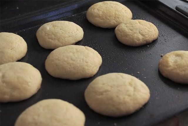 freshly baked lemon cookies on a cookie sheet