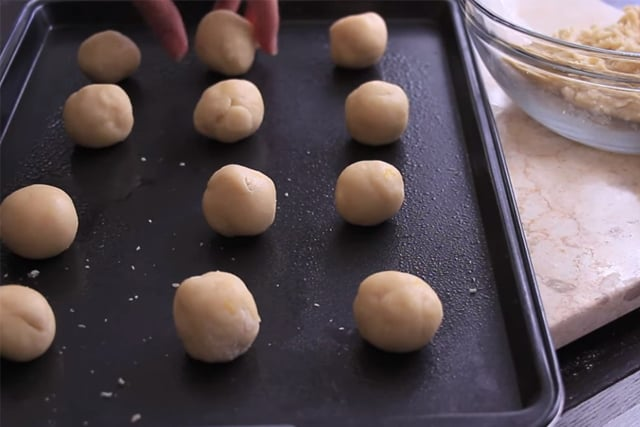 ready to bake lemon cookie dough on a cookie sheet
