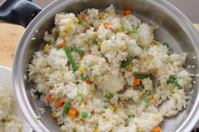 garnishing the fried rice with green onions