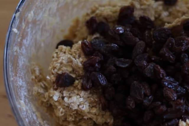adding the raisins to the oatmeal cookie dough