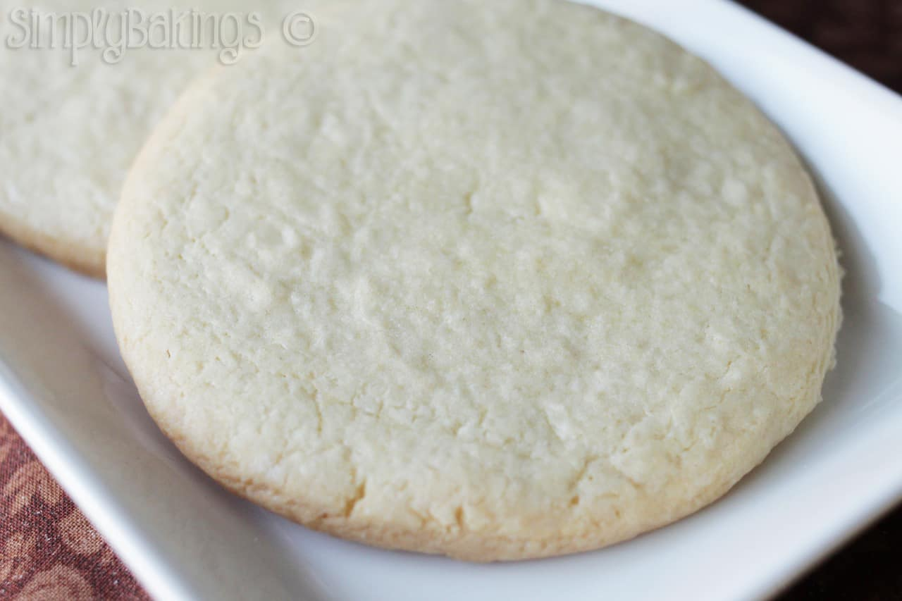 delicious rolled sugar cookies on a white plate