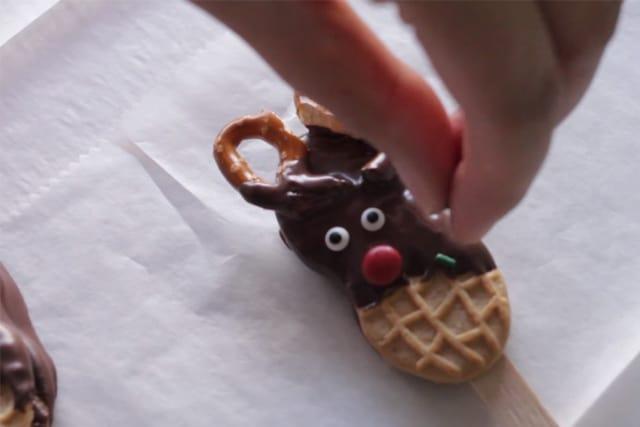 decorating the reindeer cookies