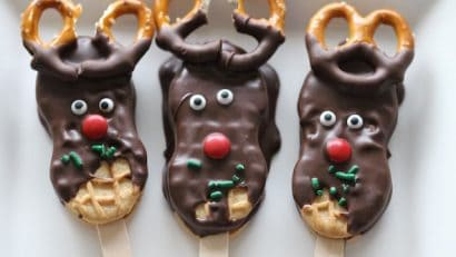 3 pieces of Reindeer Cookies on a white plate