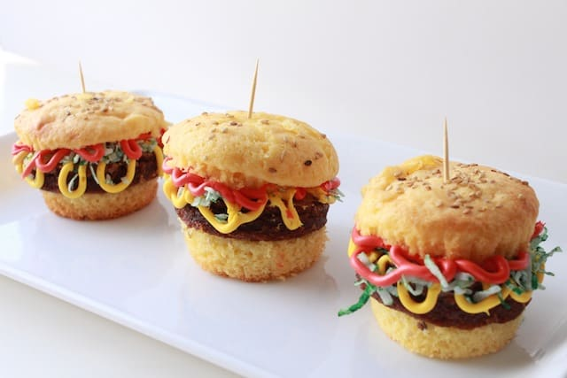 hamburger cupcakes on a white plate