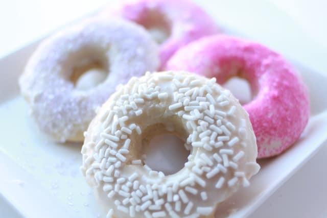 Vanilla donuts on a white plate