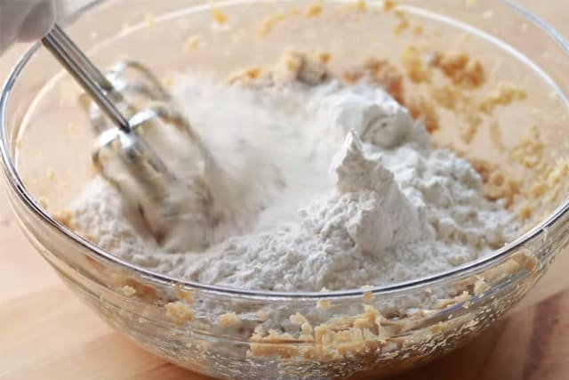 mixing the wet and dry ingredients using a handheld mixer