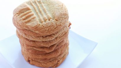 stack of peanut Butter cookies on a white plate