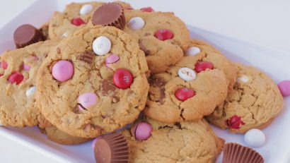 freshly baked PB Reese's cookies on a white plate