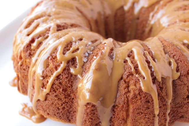 salted caramel bundt cake on a white plate