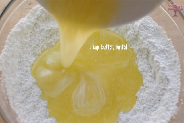 adding the melted butter to the dry ingredients of Jello cookies