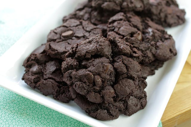 freshly baked brownie cookies on a white plate