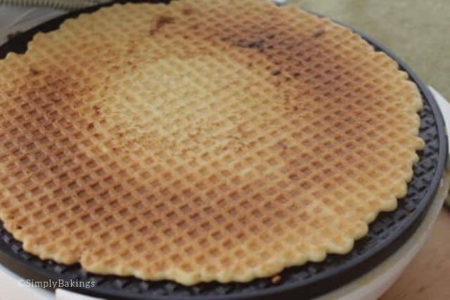 cooked waffle cone inside a waffle maker