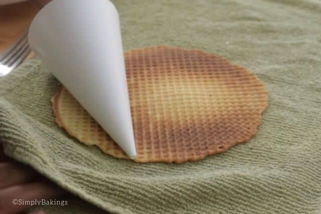 forming a waffle cone using a paper cone mold