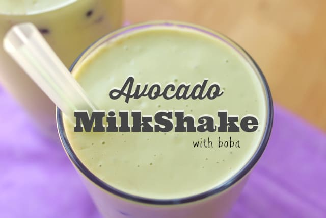 avocado shake on a tall glass with straw