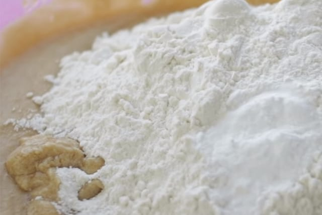mixing flour to the cookie batter