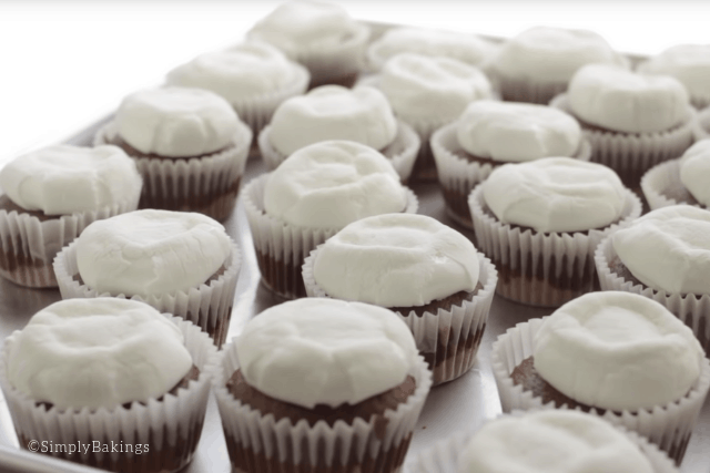 smores cupcakes with flattened marshmallows on top