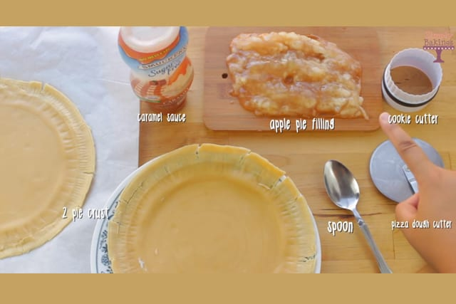 Apple Pie cookies ingredients with cookie cutter, spoon and pizza cutter