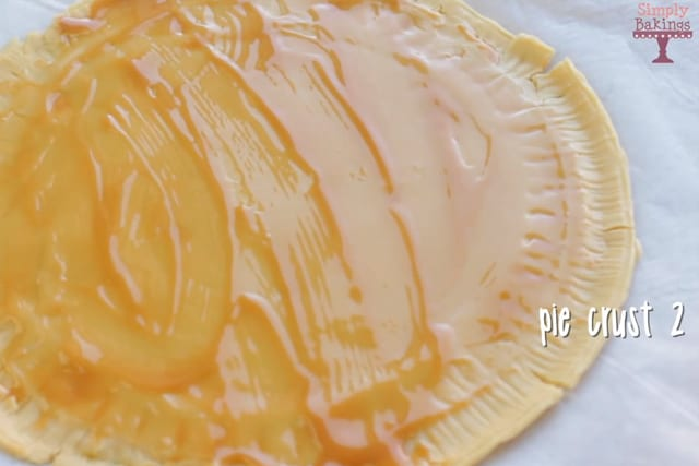 putting caramel sauce on top of the pie crust