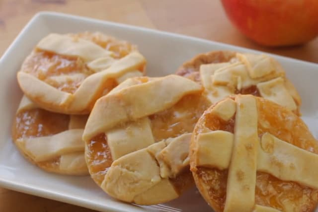 apple pie cookies on a white plate