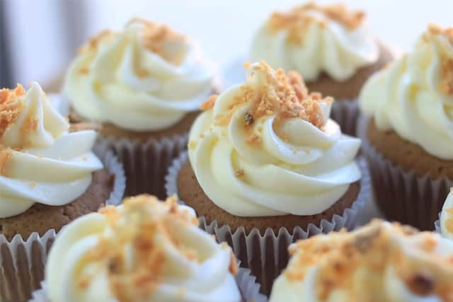 garnishing the Halloween chocolate peanut butter cupcakes