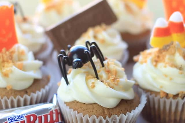 adding Halloween fun toppings to the cupcake