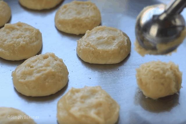 scooping apple pancake batter onto the pan
