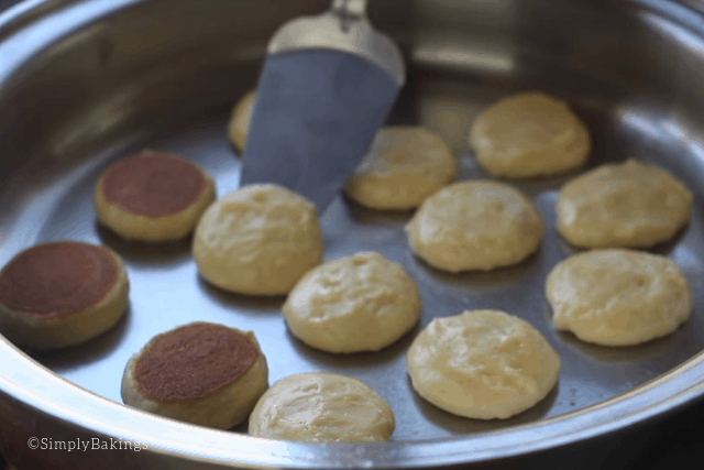 flipping the half cooked apple pancake cookies
