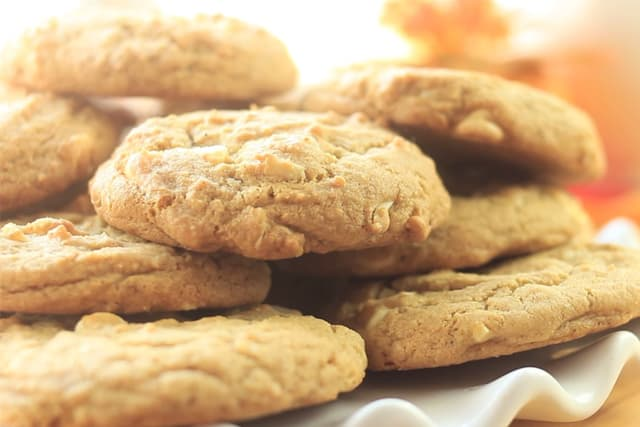 freshly baked These BEST Vanilla Chai White Chocolate Chip Cookies on a white plate
