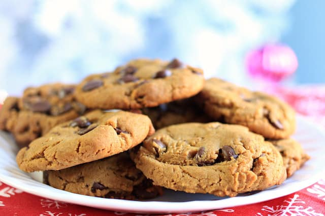 chewy and gooey gingerbread chocolate chip cookies on a white plate
