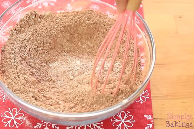 adding the cocoa powder to the cookie dough and mixing with a wire whisk