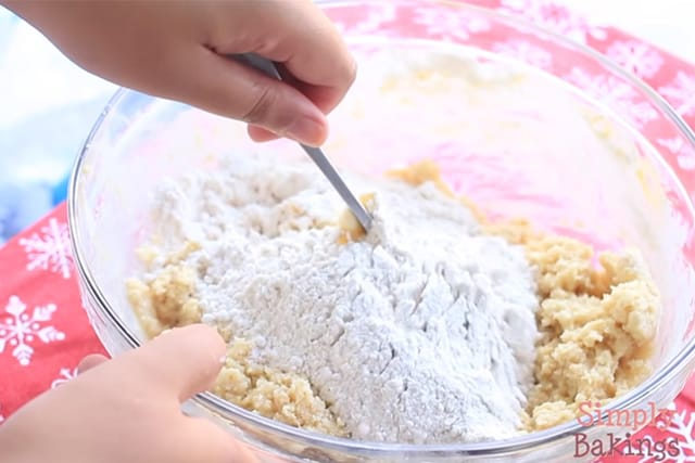 mixing the wet and dry ingredients of the eggnog cookies