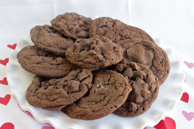 salted caramel chocolate cookies on a white plate