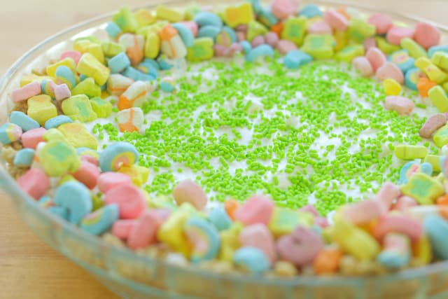 Lucky Charms Cheese Cake with green candy sprinkles