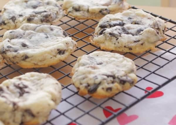 freshly baked oreo cheesecake cookies on a wire cooling rack