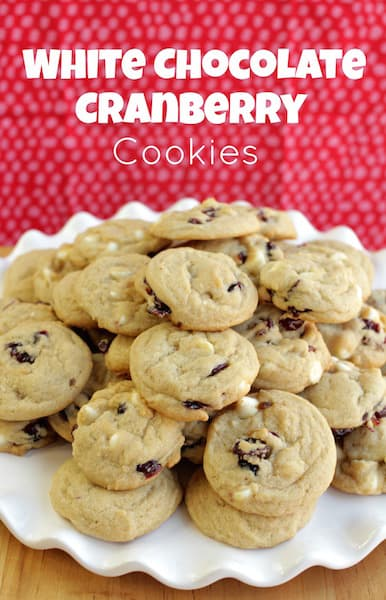 white chocolate cranberry cookies on a white plate
