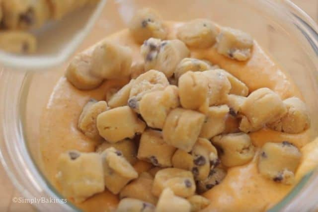 adding cookie dough to the pumpkin ice cream mixture