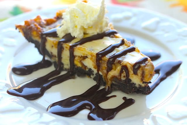 slice of Oreo Snickers Cheesecake