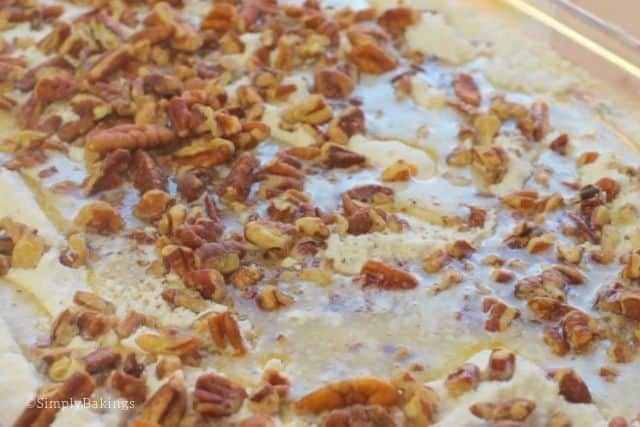 putting the melted butter and chopped pecans on top