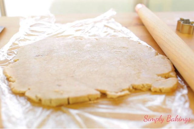 flattening the cookie dough using a rolling pin