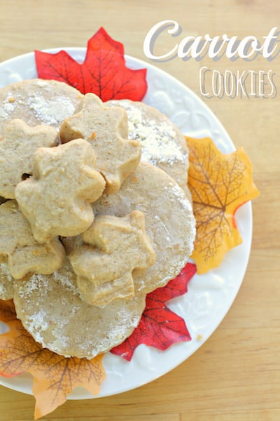 carrot cookies on a white plate with decorative autumn leaves