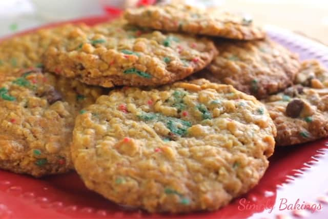 freshly baked Peanut Butter Sprinkle cookies on a red plate